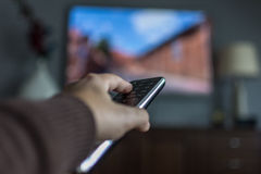 TV remote. Control in hand Stock Photos