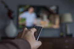 TV remote. Control in hand Stock Photography