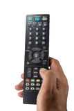 Tv remote control in hand Royalty Free Stock Image