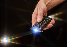 TV remote control in hand Stock Photos