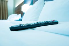 TV Remote Control in Hotel Stock Photo