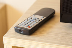 TV remote control lying on the counter. Stock Photography