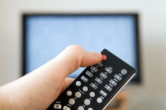 TV remote control in man's hand Royalty Free Stock Photography