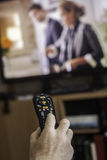 TV Remote Control. Senior sitting pointing a TV remote control Stock Image