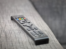 Tv remote control on sofa Royalty Free Stock Images