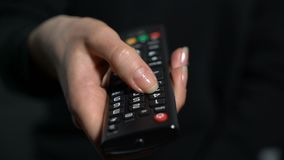 Tv remote control. Surfing television channels stock video footage