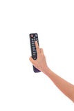 TV Remote control in Woman hand isolated Royalty Free Stock Images