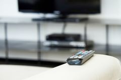 TV remote on the couch. stock photography