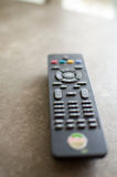 TV remote focus on volume Royalty Free Stock Image