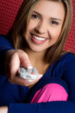 TV Remote Girl. Teen girl holding tv remote Stock Images