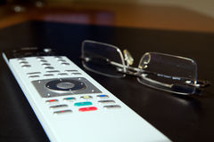 TV remote and glasses Royalty Free Stock Images