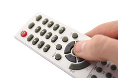 Tv remote in hand Stock Image