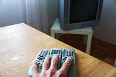 Tv remote in hand Stock Photography