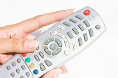 TV remote at woman hand Royalty Free Stock Images