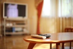 TV remotes in stylish interior Royalty Free Stock Photo