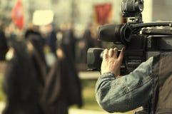 Tv reportage. News cameraman Stock Photos