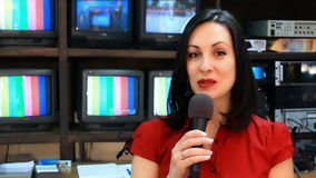 TV reporter in front of the studio camera. Beautiful newscaster presenting news in TV studio,video clip stock video