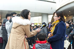 TV reporter the interview. ,reporter to interview an audience.This is in China traditional Spring Festival, Art Center Concert Hall held a variety of Stock Photos