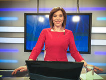 TV reporter at the news desk Royalty Free Stock Image