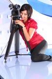TV reporter in studio. Young woman reporter posing like a photo model in TV studio Stock Photos