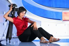 TV reporter in studio. Young woman reporter posing like a photo model in TV studio Stock Images