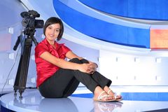 TV reporter in studio. Young woman reporter posing like a photo model in TV studio Royalty Free Stock Images