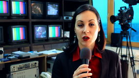 TV reporter in studio. Beautiful newscaster announces the latest news in the television studio,video clip stock video