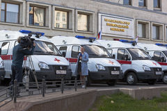 TV reporters shoot reportage on the transfer of cars first aid clinics Vologda and Cherepovets near the government building of the Stock Images