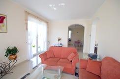 TV room with orange sofas. Elegant TV room with orange sofas Royalty Free Stock Photos