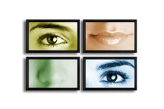 TV?s panel. Four TV?s on a white wall showing a presentation with parts of the female face Royalty Free Stock Images