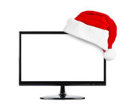 TV and Santa Claus red christmas hat stock photo