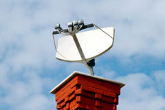 TV satellite dish. On the roof Royalty Free Stock Photography