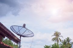 TV Satellite dish antenna on the roof house Royalty Free Stock Image