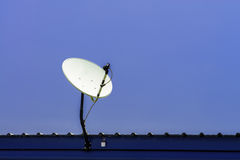TV satellite dish on blue sky Stock Photos