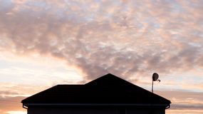 TV satellite dish. During sunset Royalty Free Stock Photo