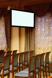 TV screen in the conference hall. Royalty Free Stock Photo