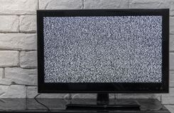 Tv screen with noise glitcher effect. No signal or no communication concept with rustic or loft style innterior. stock images