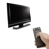 TV set. And a person with a remote in his hand Royalty Free Stock Image