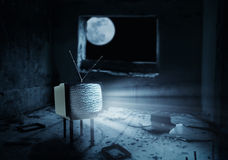 TV set in an empty room. Old TV set in an abandoned empty room in the evening Stock Photos