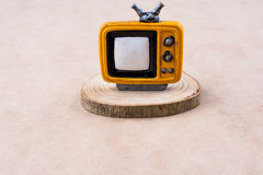 TV set on a piece of wood. Retro styled TV set  on a piece of wood Royalty Free Stock Photography