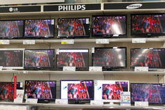TV on shelves. Shop for TVs.Rows of plasma TVs stand on shelves in supermarket Royalty Free Stock Photos