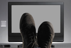 TV and shoes out of focus with neutral background Stock Photo