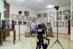 TV shooting at the Museum. LCD monitor on the camcorder. The girl in front of the camera. A record of the interview Royalty Free Stock Photos