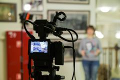 TV shooting at the Museum. LCD monitor on the camcorder. The girl in front of the camera. A record of the interview Royalty Free Stock Photography