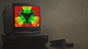 TV shows abstract pictures. TV shows a zombie video on the monitor. TV shows video hypnotizing consciousness.  stock video footage