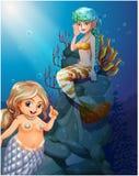 Två sjöjungfruar under havet Arkivbilder