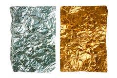 Två skrynkliga stycken av aluminum folie Arkivbild