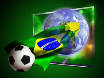 TV Soccer World Cup 2014. 3D led television from where seems to come out an Earth globe and a soccer ball surfing on a Brazilian flag Royalty Free Stock Photography