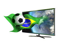 TV Soccer World Cup 2014. 3D led television from where seems to come out an Earth globe and a soccer ball surfing on a Brazilian flag Royalty Free Stock Photo