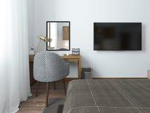 TV som hänger på väggen och skrivbordet i sovrummet i vinden Fotografering för Bildbyråer